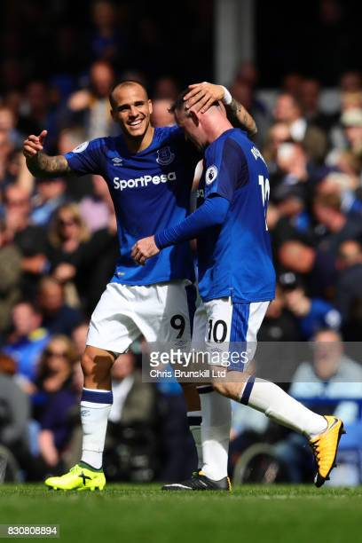 Wayne Rooney of Everton is congratulated by teammate Sandro Ramirez after scoring the opening goal during the Premier League match between Everton...