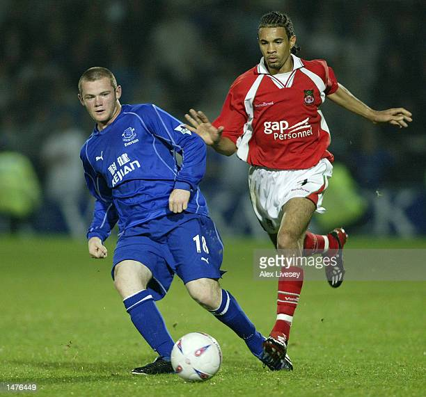 Wayne Rooney of Everton is put under pressure during the Worthington Cup second round match between Wrexham and Everton at the Racecourse Ground in...