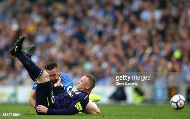 Wayne Rooney of Everton is tackled by Shane Duffy of Brighton and Hove Albion during the Premier League match between Brighton and Hove Albion and...