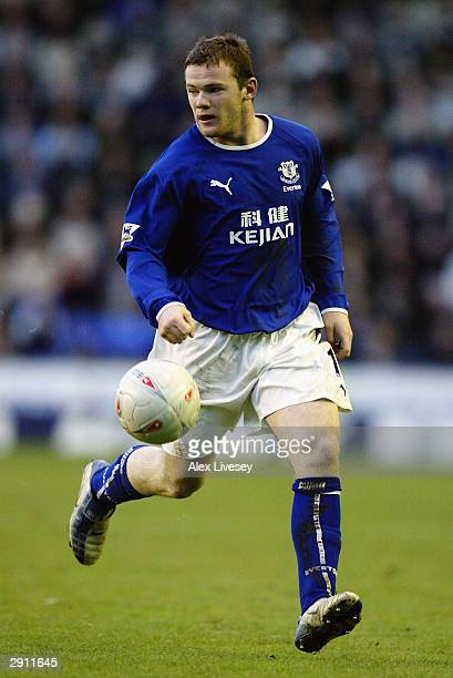 Wayne Rooney of Everton makes a break forward during the FA Cup Fourth Round match between Everton and Fulham held on January 25 2004 at Goodison...