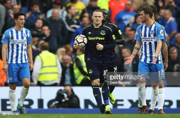 Wayne Rooney of Everton reacts after scoring the first Everton goal from the penalty spot during the Premier League match between Brighton and Hove...