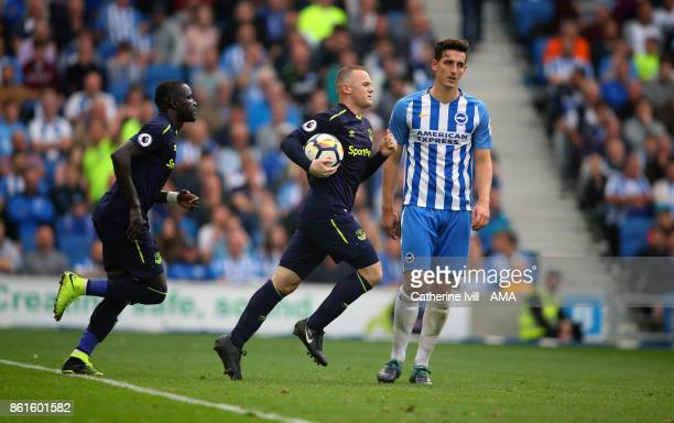 Wayne Rooney of Everton runs back to the centre with the ball after he scores a penalty goal got make it 11 during the Premier League match between...