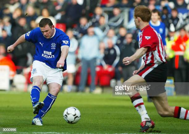 Wayne Rooney of Everton scores despite the efforts of Michael Svensson of Southampton during the FA Barclaycard Premiership match between Southampton...