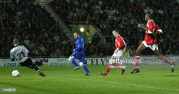 Wayne Rooney of Everton scores his first goal against Wrexham during the Worthington Cup second round match between Wrexham and Everton at the...