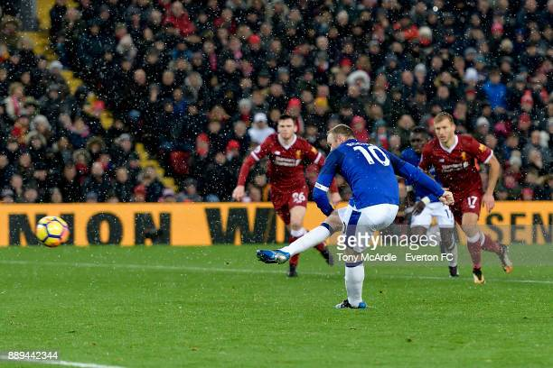 Wayne Rooney of Everton scores his penalty during the Premier League match between Liverpool and Everton at Anfield on December 10 2017 in Liverpool...