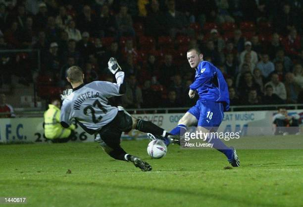 Wayne Rooney of Everton scores his second goal against Wrexham during the Worthington Cup second round match between Wrexham and Everton at the...