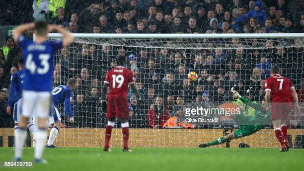 Wayne Rooney of Everton scores the first everton goal during the Premier League match between Liverpool and Everton at Anfield on December 10 2017 in...