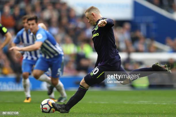 Wayne Rooney of Everton scores the first Everton goal from the penalty spot during the Premier League match between Brighton and Hove Albion and...
