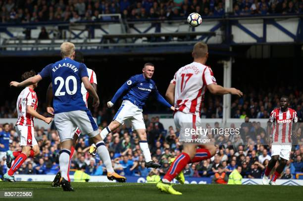 Wayne Rooney of Everton scores the opening goal during the Premier League match between Everton and Stoke City at Goodison Park on August 12 2017 in...