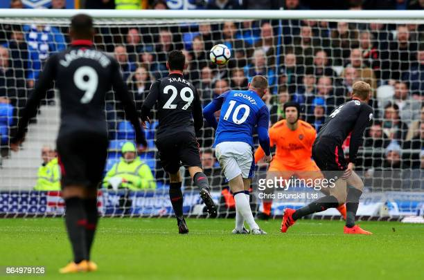 Wayne Rooney of Everton scores the opening goal during the Premier League match between Everton and Arsenal at Goodison Park on October 22 2017 in...