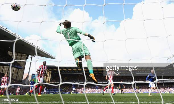 Wayne Rooney of Everton scores the opening goal past Jack Butland of Stoke City during the Premier League match between Everton and Stoke City at...