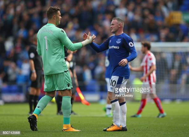 Wayne Rooney of Everton shakes hands with Jack Butland of Stoke City after the Premier League match between Everton and Stoke City at Goodison Park...