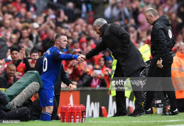 Wayne Rooney of Everton shakes hands with Jose Mourinho Manager of Manchester United after being subbed during the Premier League match between...