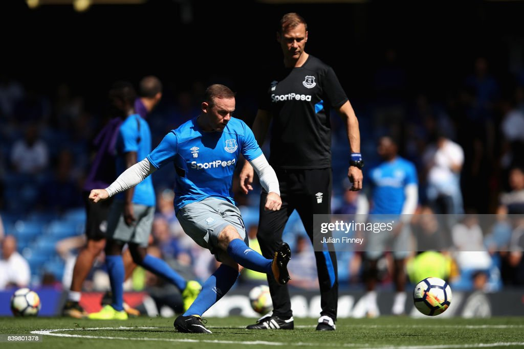 Wayne Rooney of Everton shoots while warming up as Duncan Ferguson, Everton coach looks on during the Premier League match between Chelsea and Everton at Stamford Bridge on August 27, 2017 in London, England.