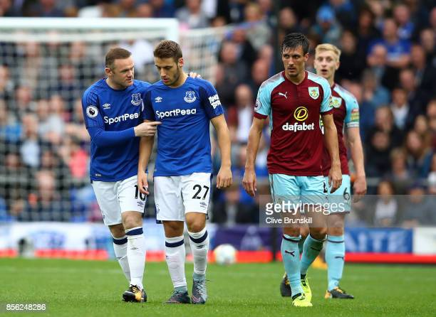 Wayne Rooney of Everton speaks to Nikola Vlasic of Everton during the Premier League match between Everton and Burnley at Goodison Park on October 1...