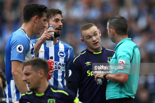 Wayne Rooney of Everton talks to Referee Michael Oliver during the Premier League match between Brighton and Hove Albion and Everton at Amex Stadium...