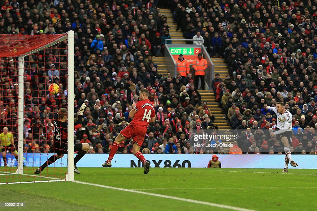 Wayne Rooney of Man Utd scores their 1st goal during the Barclays Premier League match between Liverpool and Manchester United at Anfield on January 17, 2016 in Liverpool, England.