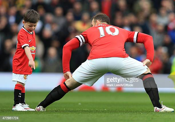 Wayne Rooney of Man Utd stretches with his son Kai as mascot prior to the Barclays Premier League match between Manchester United and Tottenham...