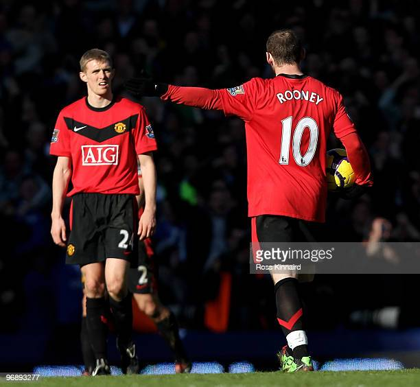 Wayne Rooney of Manchester and Darren Fletcher of Manchester during the Barclays Premiership match between Everton and Manchester United at Goodison...