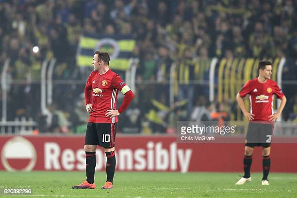 Wayne Rooney of Manchester United and Ander Herrera of Manchester United look on during the UEFA Europa League Group A match between Fenerbahce SK...
