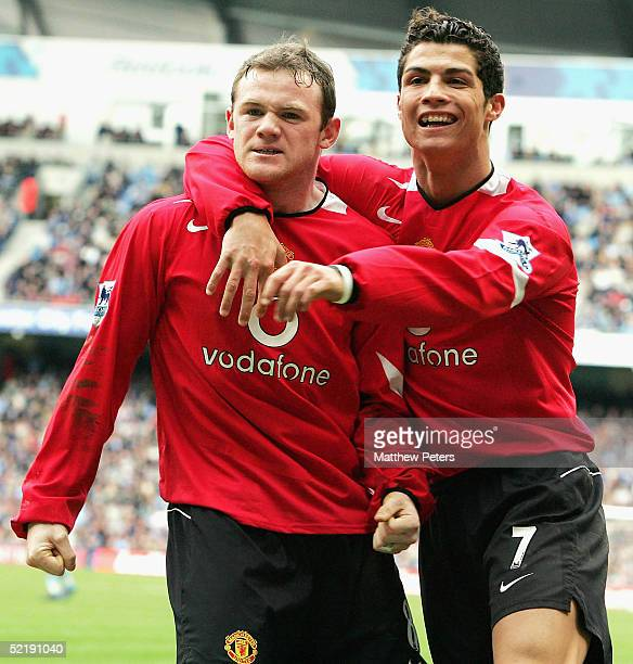 Wayne Rooney of Manchester United and Cristiano Ronaldo celebrate scoring the first goal during the Barclays Premiership match between Manchester...