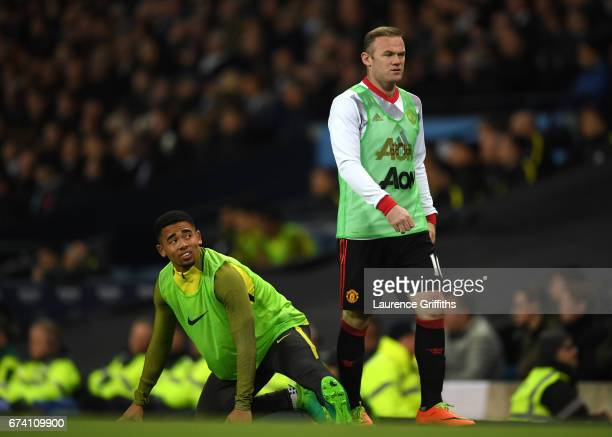 Wayne Rooney of Manchester United and Gabriel Jesus of Manchester City warm up during the Premier League match between Manchester City and Manchester...