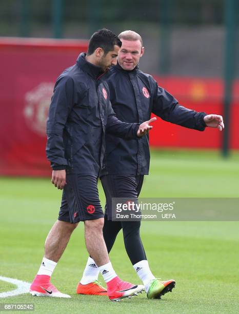 Wayne Rooney of Manchester United and Henrikh Mkhitaryan of Manchester United speak during a Manchester United training session ahead of the UEFA...
