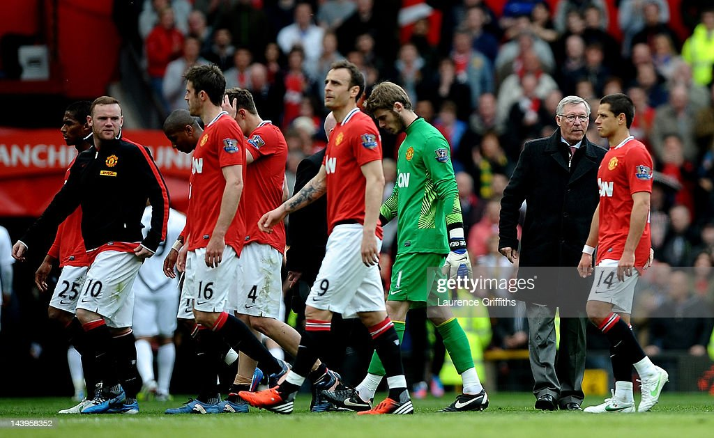 Wayne Rooney (L) of Manchester United and his team mates walk around the pitch with Manchester United Manager Sir Alex Ferguson at the end of the Barclays Premier League match between Manchester United and Swansea City at Old Trafford on 6 May 2012 in Manchester, England.