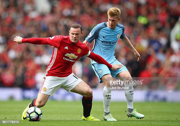 Wayne Rooney of Manchester United and Kevin De Bruyne of Manchester City battle for possession during the Premier League match between Manchester...