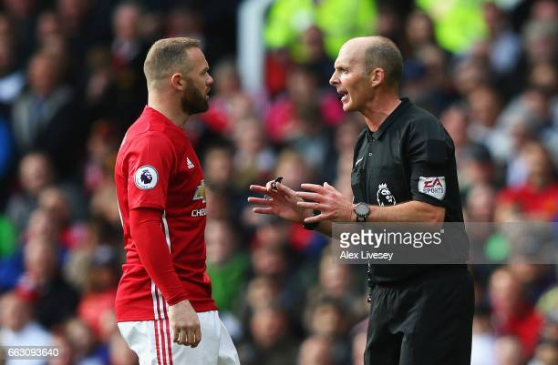Wayne Rooney of Manchester United and referee Mike Dean speak during the Premier League match between Manchester United and West Bromwich Albion at...
