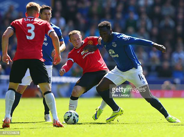 Wayne Rooney of Manchester United and Romelu Lukaku of Everton battle for the ball during the Barclays Premier League match between Everton and...