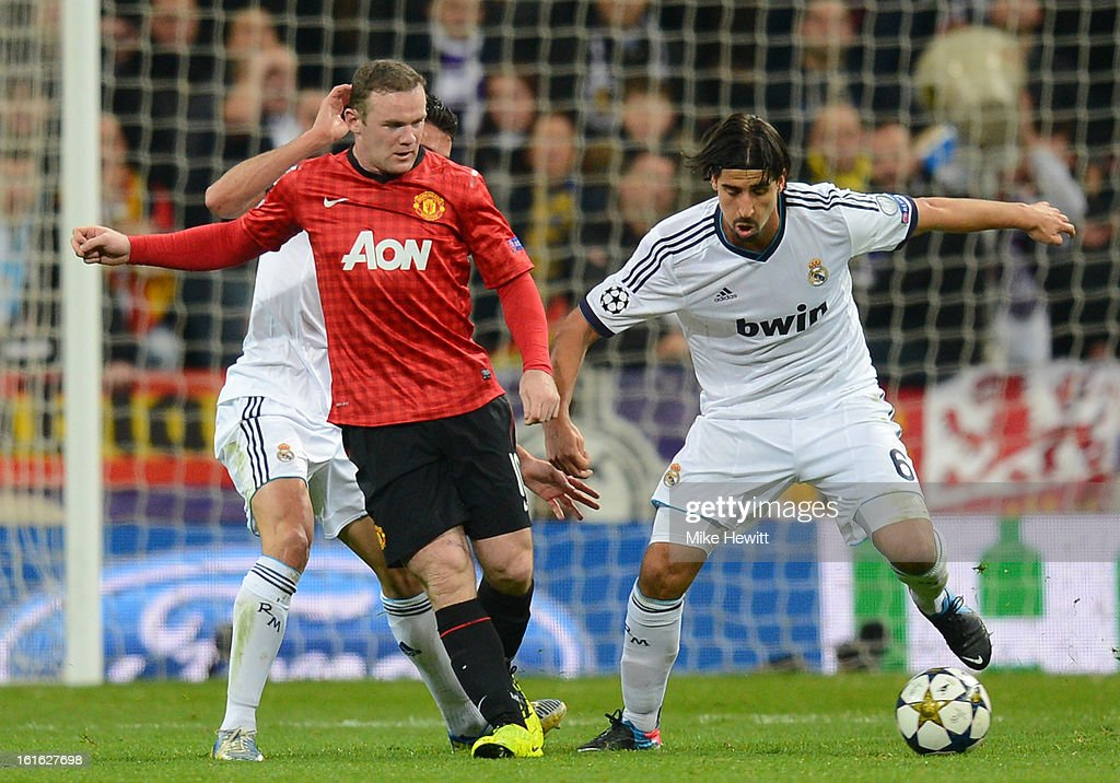 Wayne Rooney of Manchester United and Sami Khedira of Real Madrid battle for the ball during the UEFA Champions League Round of 16 first leg match between Real Madrid and Manchester United at Estadio Santiago Bernabeu on February 13, 2013 in Madrid, Spain.