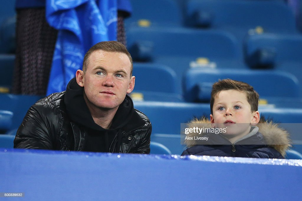 Wayne Rooney of Manchester United and son Kai attend the Barclays Premier League match between Everton and Crystal Palace at Goodison Park on December 7, 2015 in Liverpool, England.