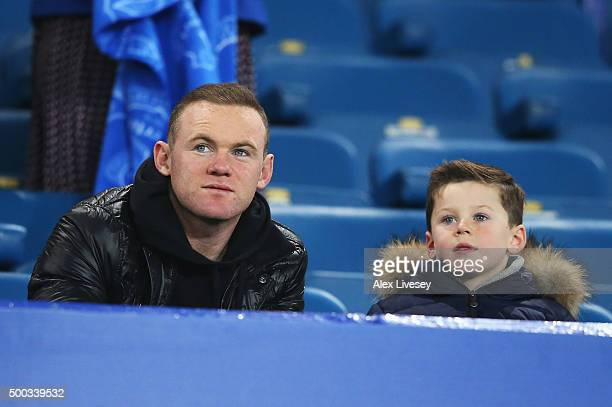 Wayne Rooney of Manchester United and son Kai attend the Barclays Premier League match between Everton and Crystal Palace at Goodison Park on...