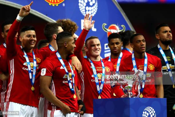 Wayne Rooney of Manchester United and teammates celebrate with the trophy in victory after during the EFL Cup Final between Manchester United and...