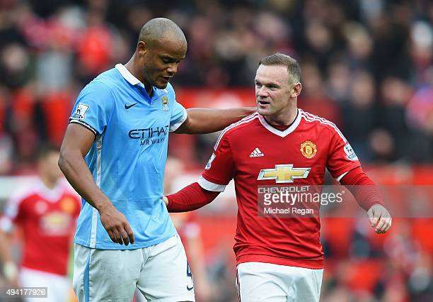 Wayne Rooney of Manchester United and Vincent Kompany of Manchester City talk as they leave the pitch at half time during the Barclays Premier League...