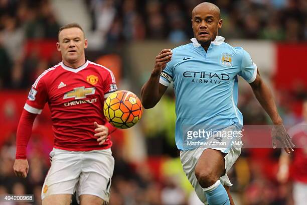 Wayne Rooney of Manchester United and Vincent Kompany of Manchester City during the Barclays Premier League match between Manchester United and...