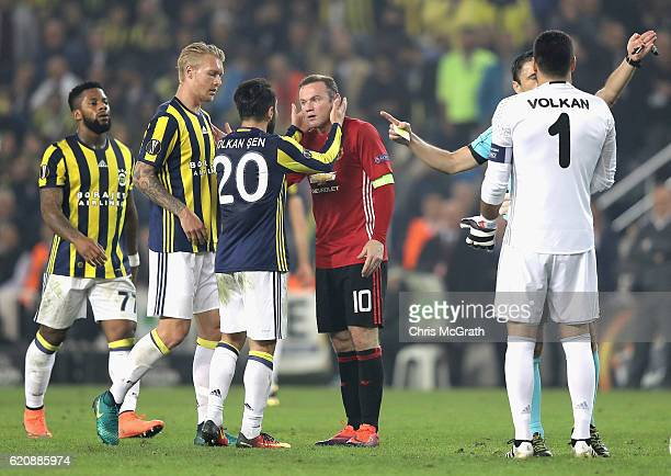 Wayne Rooney of Manchester United and Volkan Sen of Fenerbahce in conversation during the UEFA Europa League Group A match between Fenerbahce SK and...