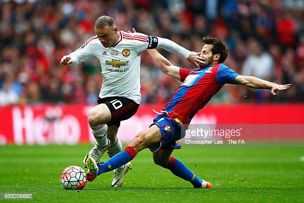 Wayne Rooney of Manchester United and Yohan Cabaye of Crystal Palace compete for the ball during The Emirates FA Cup Final match between Manchester...