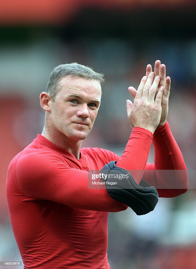 Wayne Rooney of Manchester United applauds the crowd after the Barclays Premier League match between Manchester United and Crystal Palace at Old Trafford on September 14, 2013 in Manchester, England.