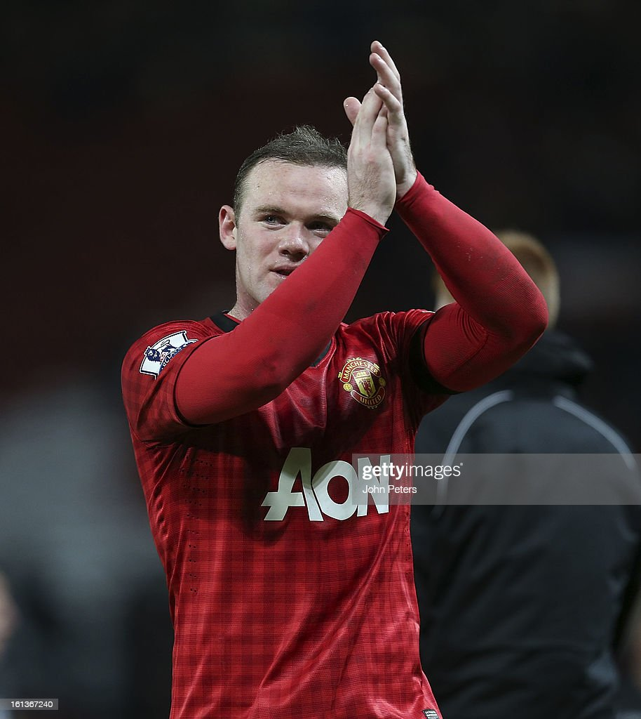Wayne Rooney of Manchester United applauds the fans after the Barclays Premier League match between Manchester United and Everton at Old Trafford on February 10, 2013 in Manchester, England.
