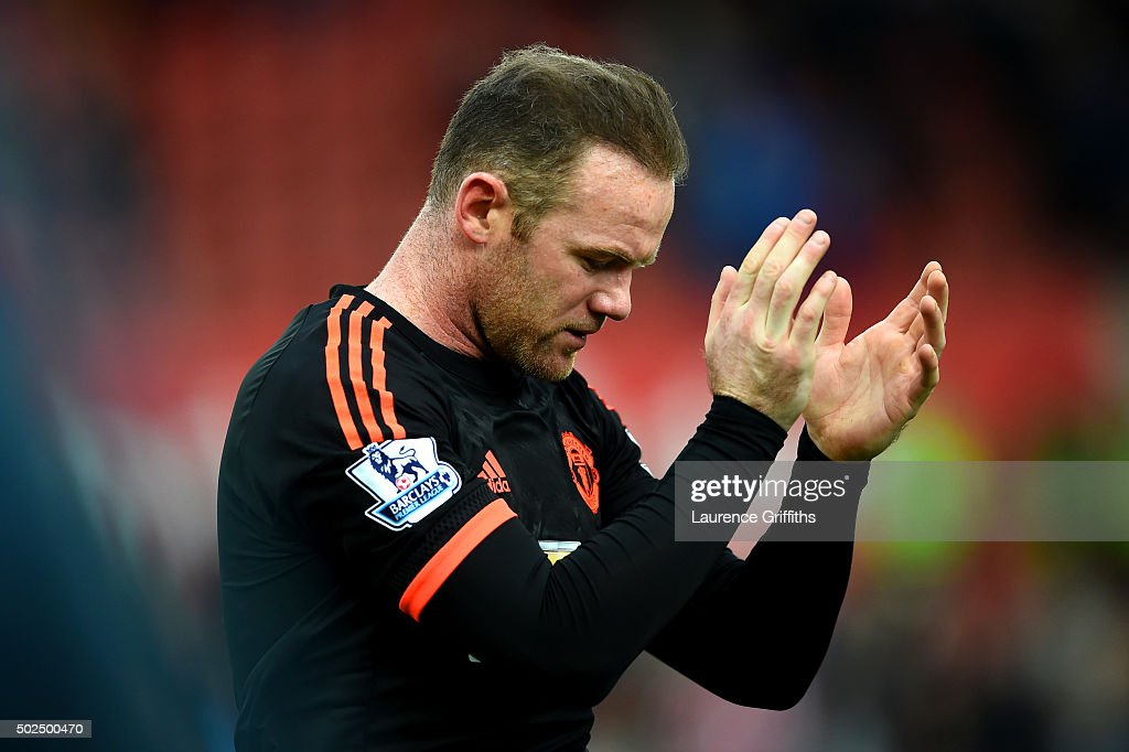 Wayne Rooney of Manchester United applauds the fans as he leaves the pitch after the Barclays Premier League match between Stoke City and Manchester United at Britannia Stadium on December 26, 2015 in Stoke on Trent, England.