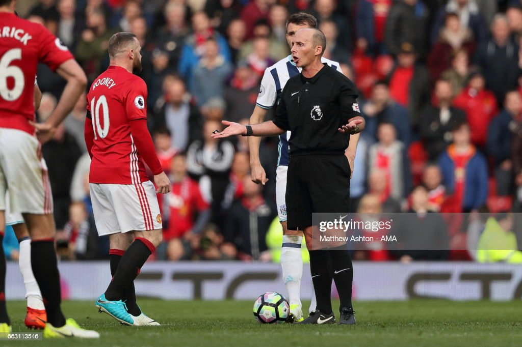 Wayne Rooney of Manchester United argues with Referee Mike Dean during the Premier League match between Manchester United and West Bromwich Albion at Old Trafford on April 1, 2017 in Manchester, England.