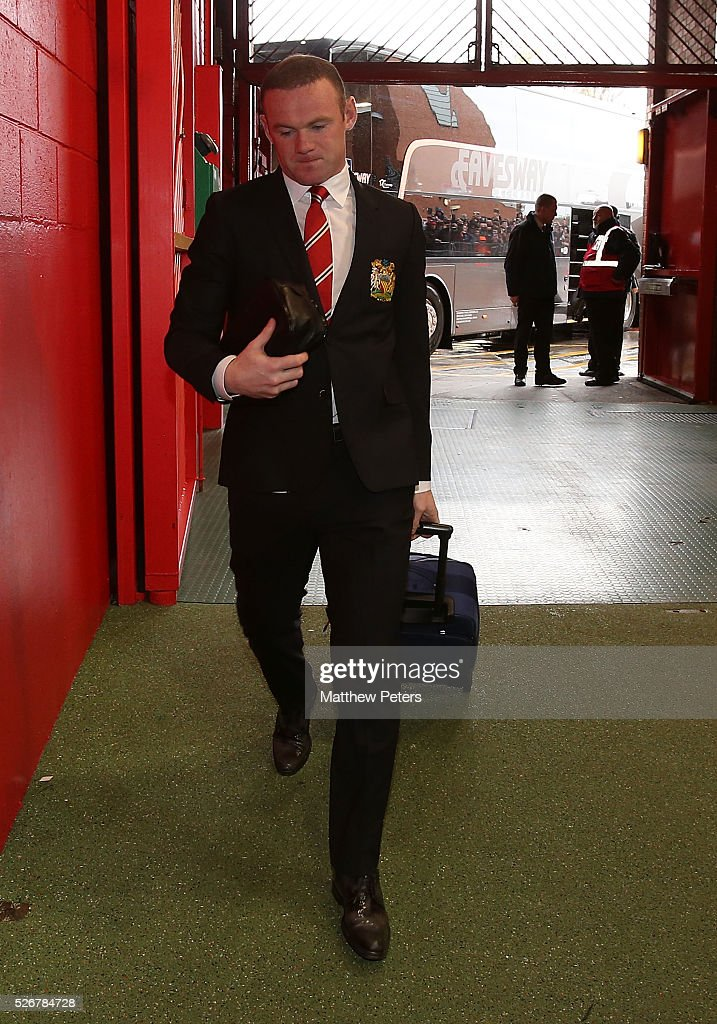 <a gi-track='captionPersonalityLinkClicked' href=/galleries/search?phrase=Wayne+Rooney&family=editorial&specificpeople=157598 ng-click='$event.stopPropagation()'>Wayne Rooney</a> of Manchester United arrives at Old Trafford ahead of the Barclays Premier League match between Manchester United and Leicester City at Old Trafford on May 1, 2016 in Manchester, England.