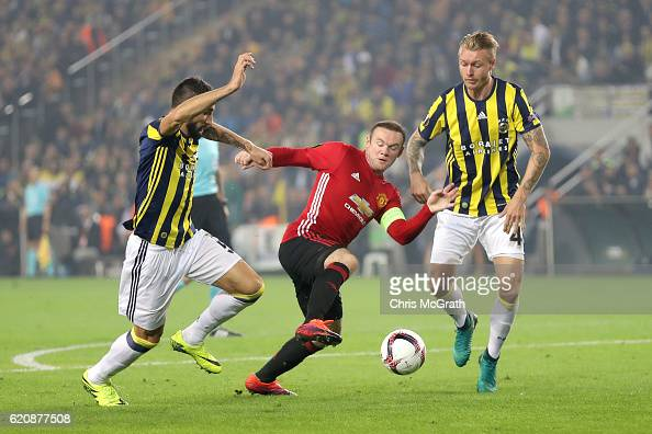 Wayne Rooney of Manchester United battles for the ball with Mehmet Topal and Simon Kjaer of Fenerbahce during the UEFA Europa League Group A match...