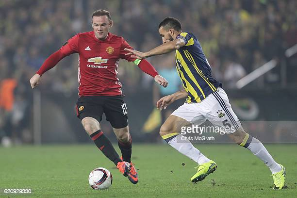 Wayne Rooney of Manchester United battles for the ball with Mehmet Topal of Fenerbahce during the UEFA Europa League Group A match between Fenerbahce...