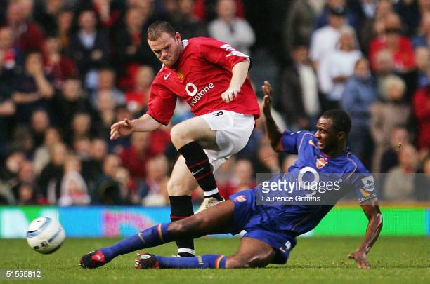 Wayne Rooney of Manchester United battles with Patrick Vieira of Arsenal during the FA Barclays Premiership match between Manchester United and...