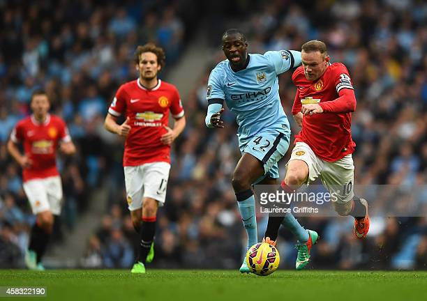 Wayne Rooney of Manchester United breaks away from Yaya Toure of Manchester City during the Barclays Premier League match between Manchester City and...