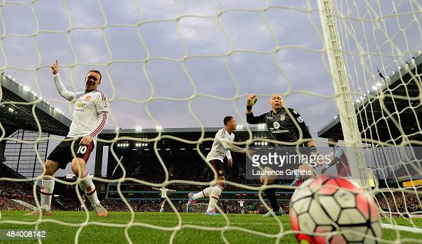 Wayne Rooney of Manchester United celebrates after Adnan Januzaj of Manchester United scored the opening goal past Brad Guzan of Aston Villa during...