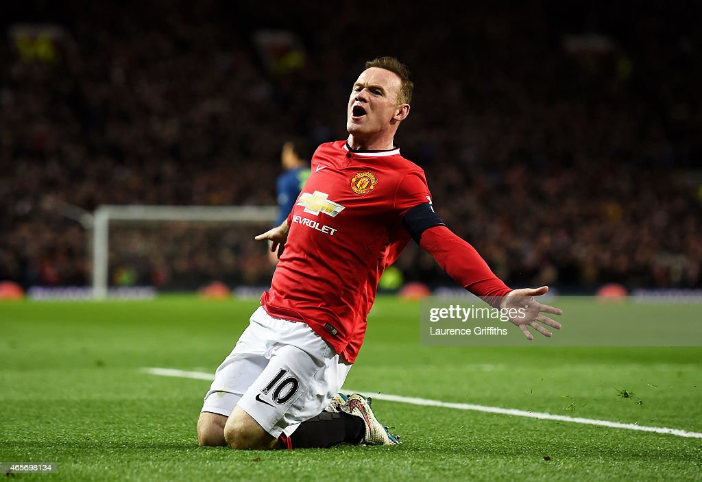 <a gi-track='captionPersonalityLinkClicked' href=/galleries/search?phrase=Wayne+Rooney&family=editorial&specificpeople=157598 ng-click='$event.stopPropagation()'>Wayne Rooney</a> of Manchester United celebrates after scoring a goal to level the scores at 1-1 during the FA Cup Quarter Final match between Manchester United and Arsenal at Old Trafford on March 9, 2015 in Manchester, England.